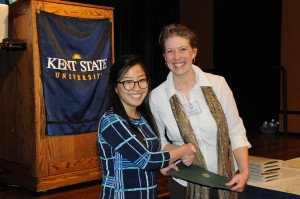 Ohio's 2015 Journalist of the Year Ivana Giang receives her award from OSMA vice president Kate Klonowski. (photo by John Bowen)