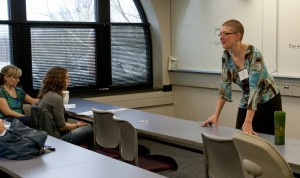 Vice President Kate Klonowski helps a group of OSMA student think about how to motivate their peers.